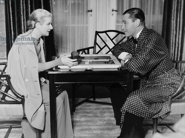THE FLAME WITHIN, from left: Ann Harding, Herbert Marshall playing backgammon on set, 1935