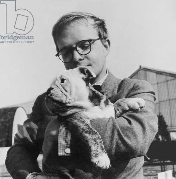 BEAT THE DEVIL, screenwriter Truman Capote and friend on location in Italy, 1953