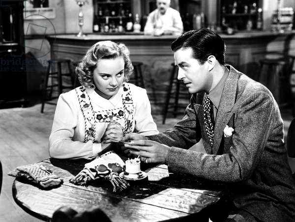 EVERYTHING HAPPENS AT NIGHT, from left, Sonja Henie, Paul Porcasi (background), Ray Milland, 1939