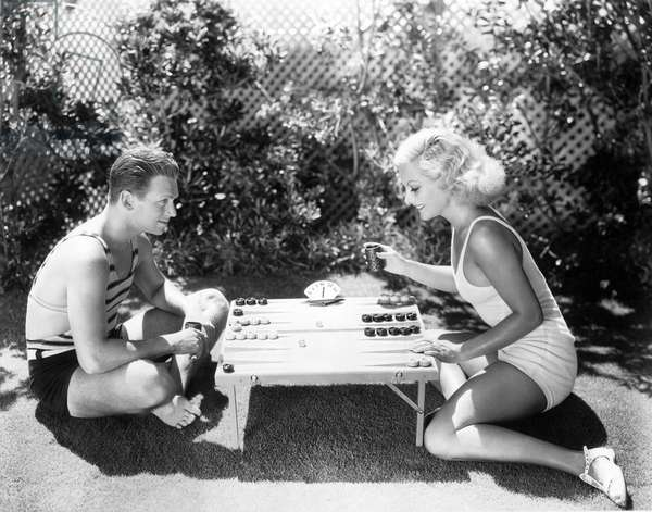 DOUGLAS FAIRBANKS, JR. and wife JOAN CRAWFORD enjoy a game of backgammon, 7/21/31