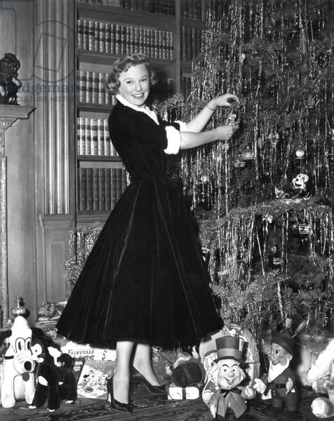 June Allyson decorates her Christmas tree, 1954
