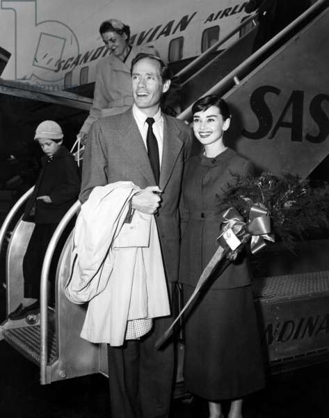 Mel Ferrer and Audrey Hepburn returning from Italy after completing filming on WAR AND PEACE, 1956