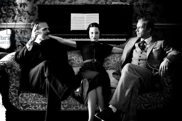 W.E., Andrea Riseborough as Wallis Simpson (center), James D'Arcy as King Edward VII (right), 2011. ©Weinstein Company/Courtesy Everett Collection