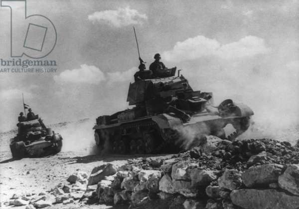 British soldiers patrolling in tanks at Tobruk: British soldiers patrolling in tanks at Tobruk, Libya, during World War 2. Ca. 1941-42. (BSLOC_2014_10_2)
