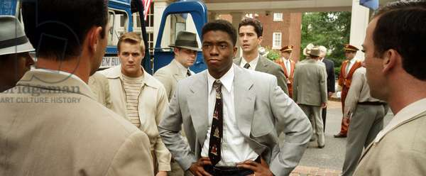 42, (aka FORTY-TWO), Lucas Black (left), Chadwick Boseman as Jackie Robinson (right of center of frame), Hamish Linklater (right of center), 2013. /©Warner Bros. Pictures/courtesy Everett Collection