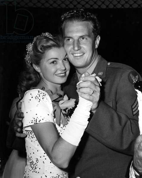 ESTHER WILLIAMS dancing with Sergeant Ben Gage at the Victory Ball at the Mocambo, Sept. 1945