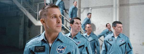 FIRST MAN, front, from left: Ryan Gosling as Neil Armstrong, Shawn Eric Jones as Wally Schirra, Patrick Fugit as Elliott See, 2018. © Universal Pictures /Courtesy Everett Collection