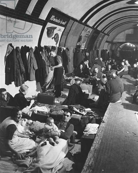 World War 2, Battle of Britain. Civilians in a London underground railroad tube converted into a Wes: World War 2, Battle of Britain. Civilians in a London underground railroad tube converted into a West End bomb shelter in the during the Blitz. Ca. 1940-41. (BSLOC_2013_11_96)