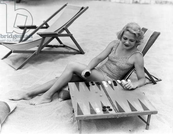 Woman Playing Backgammon on Beach