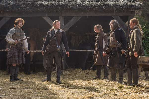 OUTLANDER, Sam Heugan (left), Douglas Henshall (2nd from left), 'The Watch', (Season 1, ep. 113, aired May 2, 2015). photo: Neil Davidson / ©Starz / courtesy Everett Collection