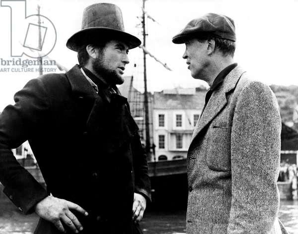 MOBY DICK, Gregory Peck, director John Huston on set, 1956