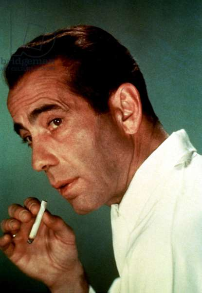Humphrey Bogart, smoking a cigarette, 1950s