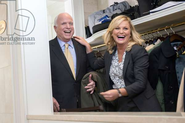 PARKS AND RECREATION, (from left): Senator John McCain, Amy Poehler, 'Ms. Knope Goes To Washington', (Season 5, ep. 501, airs Sept. 20, 2012), 2009-. photo: David Giesbrecht / © NBC / Courtesy Everett Collection