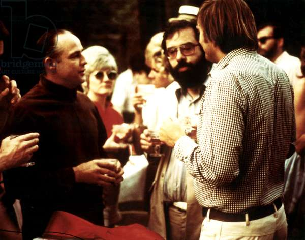 MARLON BRANDO listens to director FRANCIS FORD COPPOLA on the set of THE GODFATHER, 1972