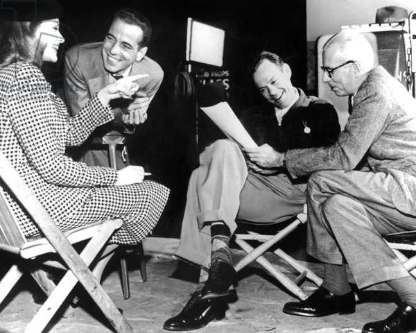 Lauren Bacall, Humphrey Bogart, John Ridgely with director Howard Hawks on set of The Big Sleep, 1946