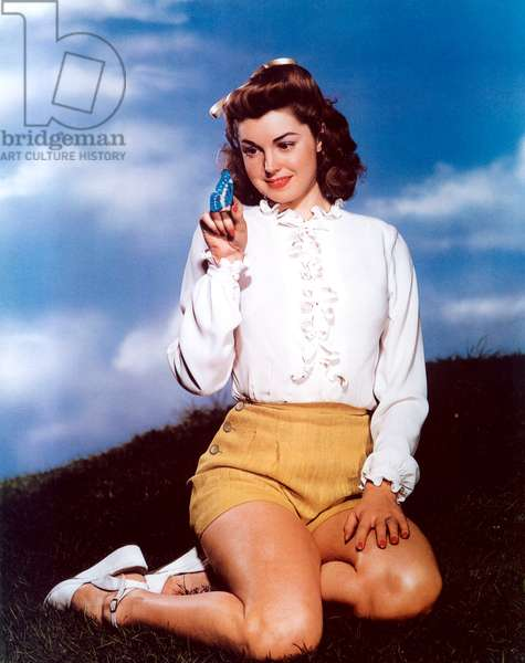 ESTHER WILLIAMS holding a butterfly.