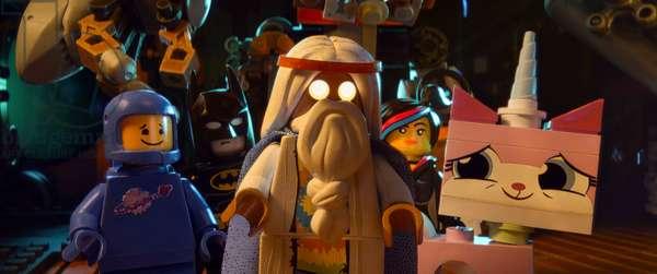 THE LEGO MOVIE, from left: Benny (voice: Charlie Day), Batman (voice: Will Arnett), Vitruvius (voice: Morgan Freeman), Wyldstyle (voice: Elizabeth Banks), Unikitty (voice: Alison Brie) 2014. ©Warner Bros. Pictures/courtesy Everett Collection