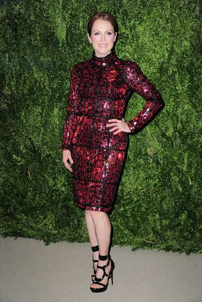 Julianne Moore (wearing a Tom Ford dress) at arrivals for 2013 CFDA Vogue Fashion Fund Awards Gala Dinner, Spring Studios, New York, NY November 11, 2013. Photo By: Gregorio T. Binuya/Everett Collection