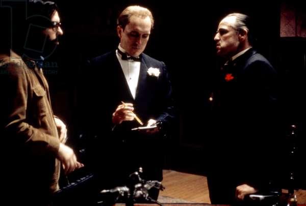 THE GODFATHER, director Francis Ford Coppola, Robert Duvall, Marlon Brando on set, 1972