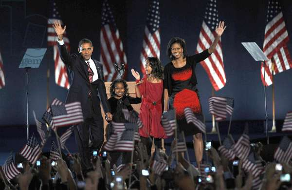 U.S. President Elect Senator Barack Obama, daughter Sasha Obama, daughter Malia Obama, wife Michelle Obama (wearing a Narciso Rodriguez dress) at a public appearance for Barack Obama U.S. Presidential Election Victory Speech and Celebration, Grant Park, Chicago, IL, November 04, 2008. Photo by: Kristin Callahan/Everett Collection