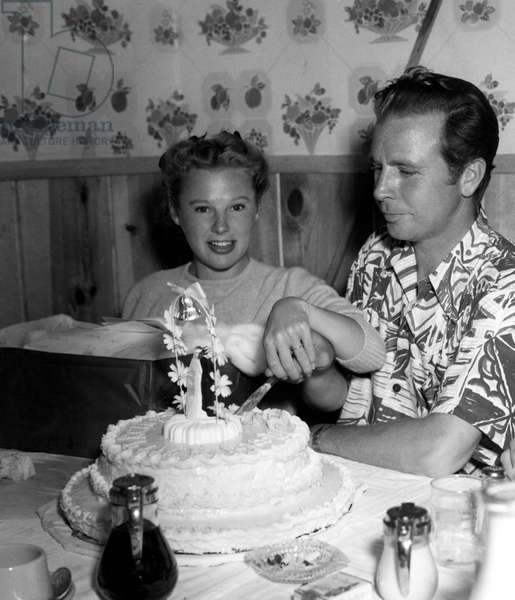 JUNE ALLYSON visits husband DICK POWELL at RKO (during production of STATION WEST) to celebrate their first wedding anniversary, 1948