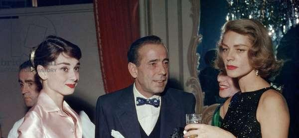 Audrey Hepburn, Humphrey Bogart and Lauren Bacall, 1950s.