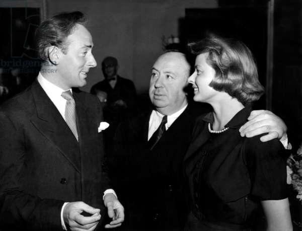 UNDER CAPRICORN, from left: Michael Wilding, director Alfred Hitchcock, Ingrid Bergman prior to filming, 1948