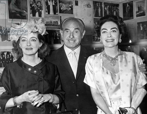WHAT EVER HAPPENED TO BABY JANE?, Jack Warner posing with stars Bette Davis, Joan Crawford in his office, 1962