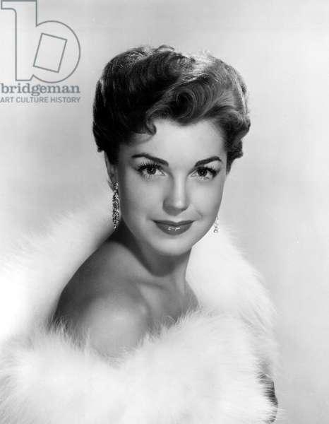 ESTHER WILLIAMS wearing fur, 1952.