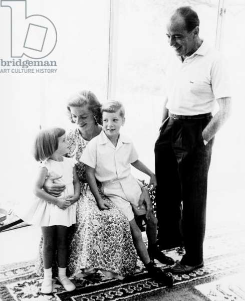 Lauren Bacall (seated) flanked by daughter Leslie Bogart and son Stephen Bogart with Humphrey Bogart standing right, ca. 1956
