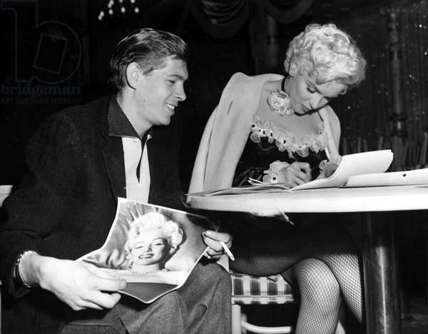 Marilyn Monroe autographing her picture for Johnnie Ray on the set of THERE'S NO BUSINESS LIKE SHOW BUSINESS, 1954