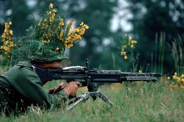 Vietnam War. A camouflaged infantryman armed with an M60 machine gun. 1972: Vietnam War. A camouflaged infantryman armed with an M60 machine gun. 1972