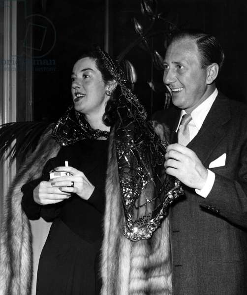 """ROSALIND RUSSELL and husband, Fred Brisson, at party for """"Guilt of Janet Ames"""" and """"It's a Wonderful Life"""". 1946."""