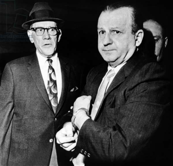 Jack Ruby: Handcuffed Jack Ruby, killer of JFK assassin Lee Harvey Oswald, escorted by Dallas County Sheriff Bill Decker, to a sanity evaluation, Dallas, Texas. 1963.