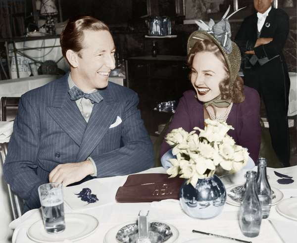 Couple Sitting Together at a Table Having Fun