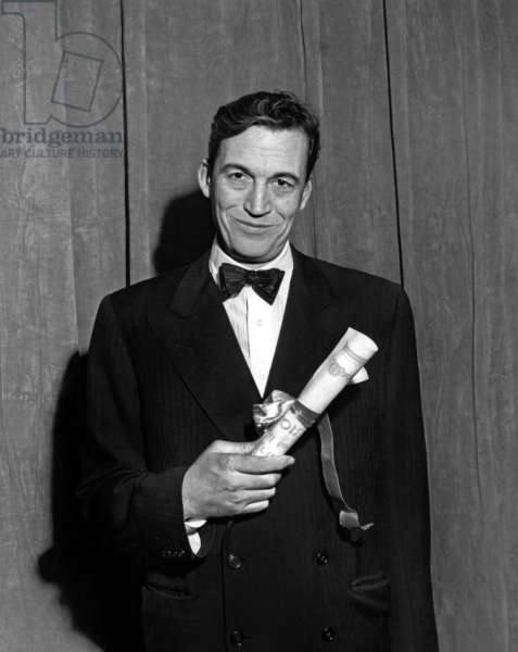"""John Huston with the N.Y. Film Critics Award for Best Director for """"Treasure of The Sierra Madre"""" 1948  (b/w photo)"""
