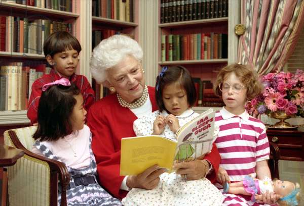 Barbara Bush: First Lady Barbara Bush reads to children in the White House Library. As First Lady, she supported literacy programs and encouraged family reading. July 24, 1990.