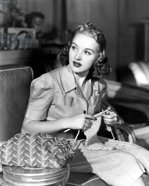 Betty Grable knitting on the set, 1938