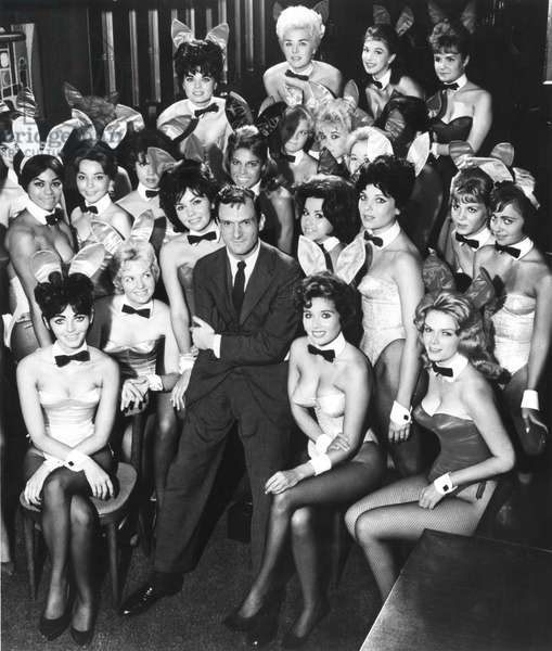 HUGH HEFNER: ONCE UPON A TIME, Hugh Hefner (center) surrounded by two dozen of the original Bunnies from the first Playboy Club in Chicago in 1960.