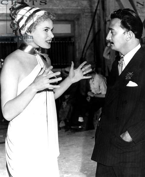 INGRID BERGMAN, talking to Salvador Dali on set of Alfred Hitchcock's 'Spellbound'