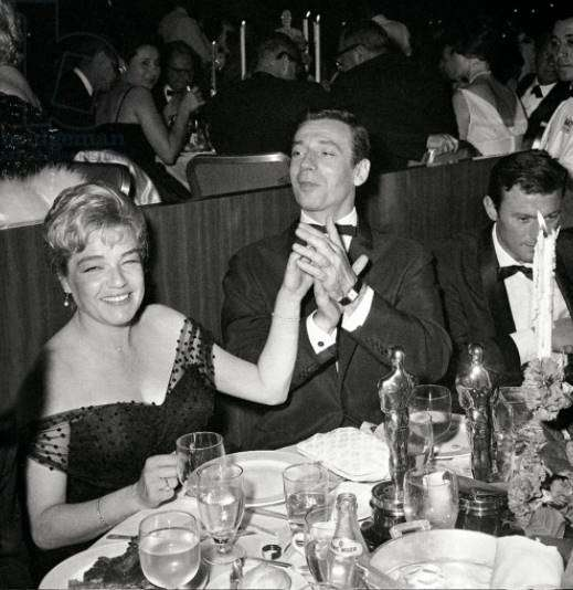 Simone Signoret, Yves Montand celebrating the Best Actress Academy Award for ROOM AT THE TOP, 1960 (b/w photo)