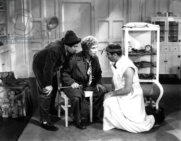 DAY AT THE RACES: A DAY AT THE RACES, Chico Marx, Harpo Marx, Groucho Marx, 1937, doctor examining patient and vice versa
