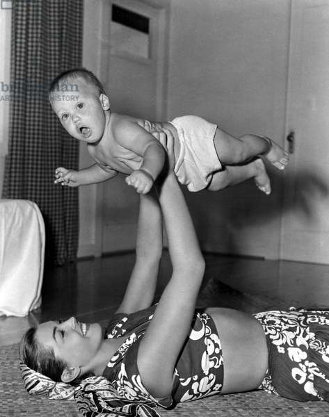 ESTHER WILLIAMS plays with her son, Ben, Jr., while filming Pagan Love Song. 1950