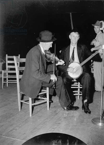R.J. Boyd, fiddle, and Millard Garrett, banjo; of Sandy Marsh, N.C. at Mountain Music Festival,: R.J. Boyd, fiddle, and Millard Garrett, banjo; of Sandy Marsh, N.C. at Mountain Music Festival, Asheville, North Carolina, circa late 1930s-early 1940s
