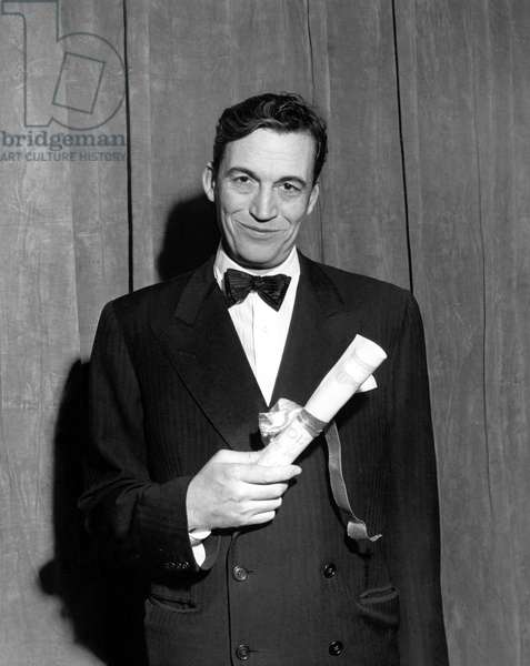 """John Huston with the N.Y. Film Critics Award for Best Director for """"Treasure of The Sierra Madre"""", circa 1948"""