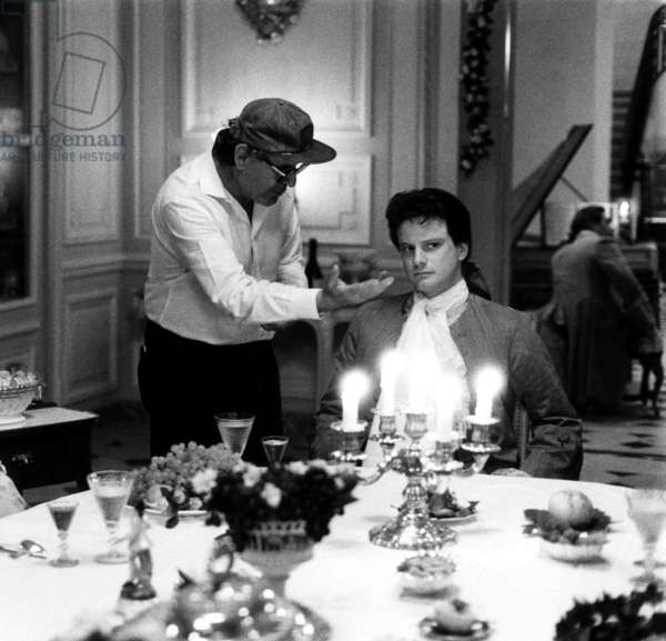 Valmont: VALMONT, from left, Meg Tilly, director Milos Forman, Colin Firth, on-set, 1989, ©Orion Pictures/courtesy Everett Collection