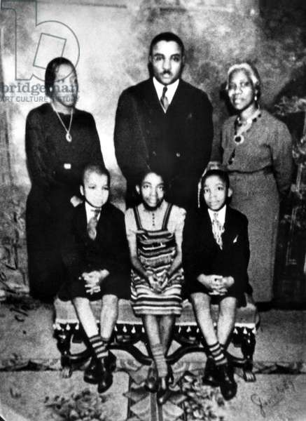 MARTIN LUTHER KING, Jr. appears(front row, right) in an early photo with his family. From L to R: Alberta Williams King (mother), Martin Luther King, Sr. (father), Jennie Williams (grandmother), brother Alfred Daniel and sister Christine. Year unknown.
