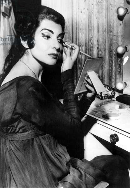 MARIA CALLAS applying makeup for a performance of MEDEA in Dallas, 1959