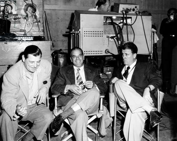A PLACE IN THE SUN, from left: second unit director Fred Guiol, visitor Frank Capra, director George Stevens on set, 1951