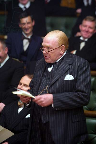 THE GATHERING STORM, Albert Finney (as Winston Churchill), making a speech before Parliament, 2002. Courtesy: Everett Collection